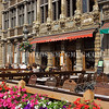 People sit at a cafe in the Grand Place, Brussels, Belgium